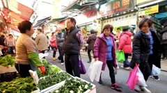 People shopping greengrocery on the traditional asian street market. Hong Kong Stock Footage