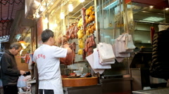 People shopping meat on the traditional asian street market. Hong Kong Stock Footage