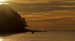 Paddling a Fishing Boat at Sunset Stock Footage