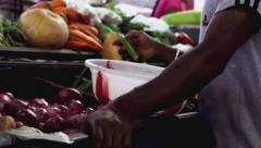 Man buys vegetables on indian local market Stock Footage