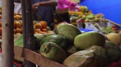 People buy exotic fruits on the local indian market Stock Footage