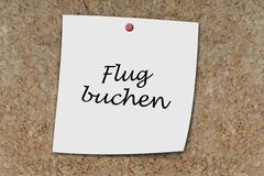 Flug buchen written on a memo Stock Photos