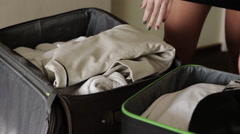 Girl girlfriend collect things in suitcases - stock footage