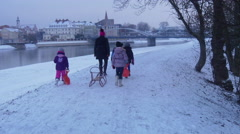 Kids Are Walking Along a River Pulling a Sled Wintry Landscape Bridge through Stock Footage