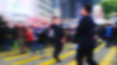Blurred slow motion video of people moving at crossroad. Hong Kong  Stock Footage