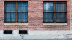 Two Windows on brick red wall Stock Photos