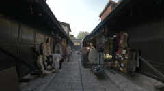 Street with traditional clothing and souvenir shops in Sarajevo Stock Footage