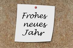 Frohes neues Jahr written on a memo Stock Photos
