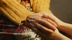Old woman young woman hold hand wrinkle skin close up - stock footage
