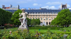 Sculpture of the boy in the garden of the Palais Royal in Paris Stock Footage