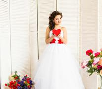 Happy Valentine's Day. Bride with red heart. Wedding and Valentine concept Stock Photos