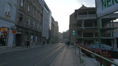 People walking and driving on Mula Mustafe Baseskije in Sarajevo Stock Footage