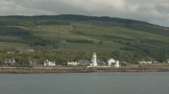 Passing Toward Point Lighthouse on the Firth of Clyde, Scotland Stock Footage