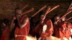 African tribe warrior dancers with horn, tribesmen dance sing songs jump clap Stock Footage