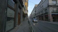 People walking and driving near Aanadolu Agency in Sarajevo Stock Footage