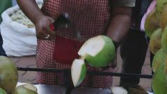 Man cuts coconut to make a drink Stock Footage