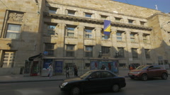 Driving cars in front of the Central Bank of Bosnia and Herzegovina in Sarajevo Stock Footage