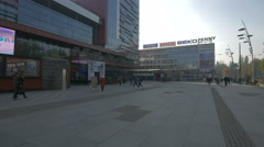 People walking near the shopping mall in Trg djece Sarajeva, Sarajevo Stock Footage