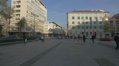 People walking in Trg djece Sarajeva in Sarajevo Stock Footage