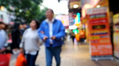 Live camera motion video of people walking at crowded modern city. Hong Kong - stock footage