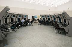 Air Traffic Controllers in air traffic control center with monitors and radar - stock photo