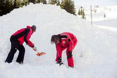 Rescuers at Mountain Rescue Service at Bulgarian Red Cross are scooping the s - stock photo