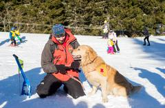 Rescuer and his service dog at Mountain Rescue Service at Bulgarian Red Cross - stock photo