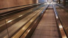 Moving walkway or sidewalk ride in modern architectural interior, no people. - stock footage