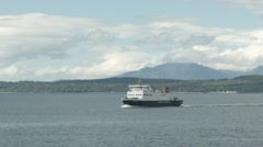 A distant view of the Rothsay Ferry crossing the Firth of Clyde Stock Footage