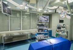 Modern operating room with surgery table, effective lights and life support s - stock photo