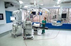 Surgeon operates with an arthroscope, arthroscopy camera and probe in new and - stock photo