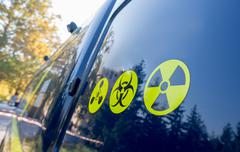 Warning radiation sign, bio-hazard sign and warning sign. Stock Photos