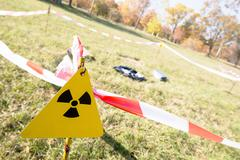 Warning radiation sign marking a zone of alienation with potentian radioactiv Stock Photos