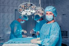 Team surgeon at work in operating room. breast augmentation - stock photo