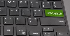 Job search keyboard button green color Stock Photos