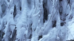 Beautiful icicles from waterfall in slow motion Stock Footage