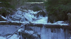 Frozen river with frozen wood and stone bridge Stock Footage