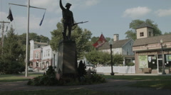 Soldier Statue on Town Green, American village establishing shot Stock Footage