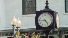 Clock tower in small town village, establishing shot Stock Footage