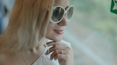 Happy woman admire the view from the window of a moving train - stock footage