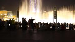 People watch music fountain show at Dubai Downtown, time lapse shot Stock Footage