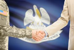 American soldier in uniform and civil man in suit shaking hands with USA stat Stock Photos