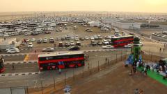 Large car parking at flat deserted area, car rush away, vehicle flow pass turn - stock footage