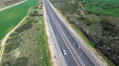 Aerial footage of Highway road with traffic passing Stock Footage