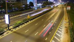 Bright illuminated night road, quick traffic motion, smooth time lapse shot Stock Footage