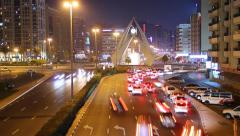 Car traffic gather in crowd at Dubai Clock Tower roundabout, night time lapse Stock Footage