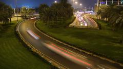 Multiple roads fast traffic flow in night, bend road, underpass exit, time lapse Stock Footage