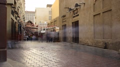 Smooth trace of people rush over old souk walkway, time lapse, evening Stock Footage