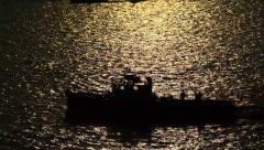 Dark motorboat silhouette move along Dubai Creek, high contrast, sun light Stock Footage