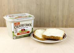 Container of Country Crock Vegetable Oil Spread and Buttered Bread Stock Photos